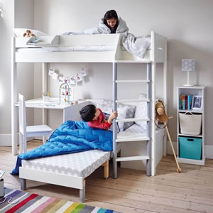 Kids white, high sleeper bed which incorporates a desk and sofa bed.