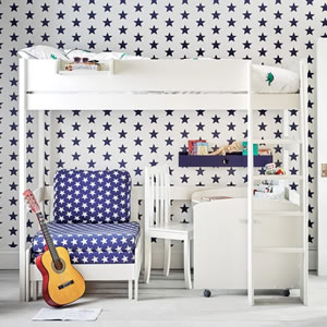 White wood high sleeper with attached single sofa bed in a blue and white fabric.