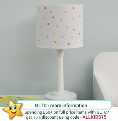 from GLTC, a children's white, bedside lamp, with pastel polka dot pattern to the shade.