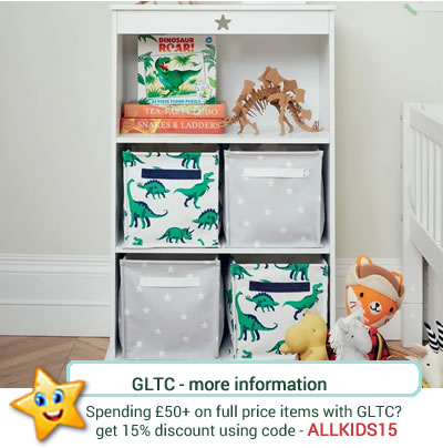 White bookcase/ storage unit from GLTC, with star cut out detail to the top. Three shelves and deep enough to take cube storage hampers.