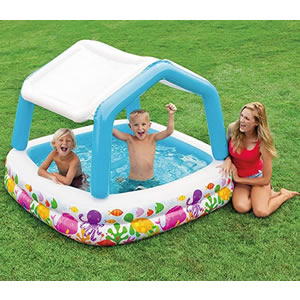 Under water themed splash pool with removable sun shade.