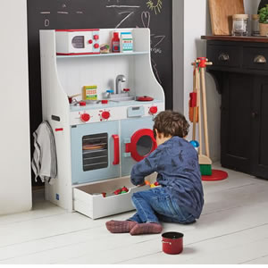 St Ives, small wooden play kitchen with oven, washing machine, hob and sink.